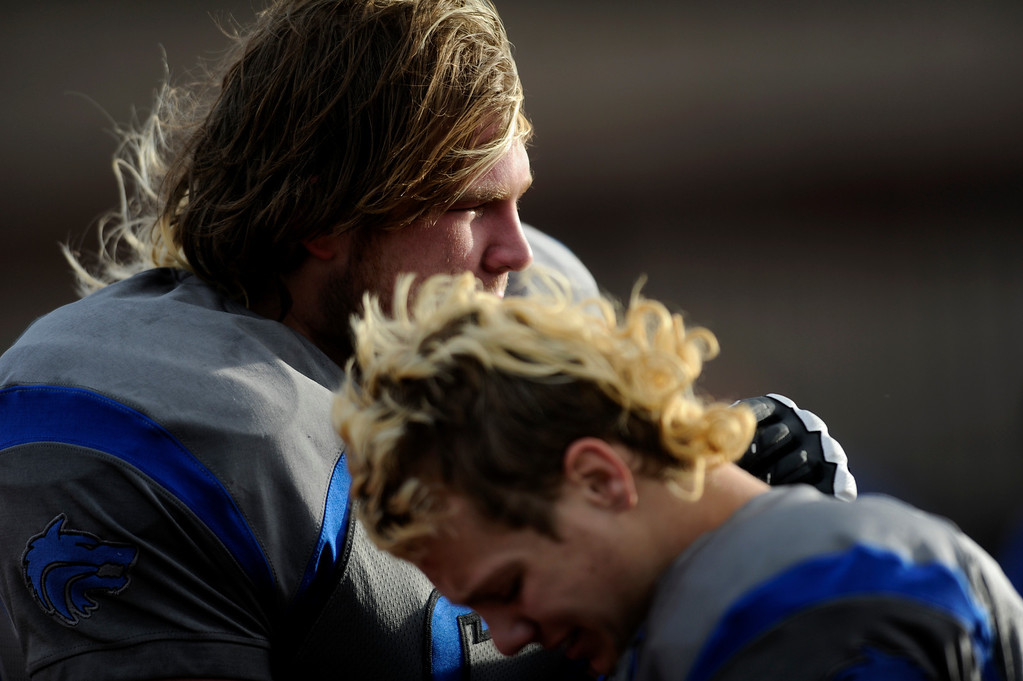 . AURORA CO: Nov. 16, 2013  Grandview\'s Connor Thrush and Keifer Glau console each other after their 9 - 13 loss to ThunderRidge.   (Photo By Erin Hull/The Denver Post)