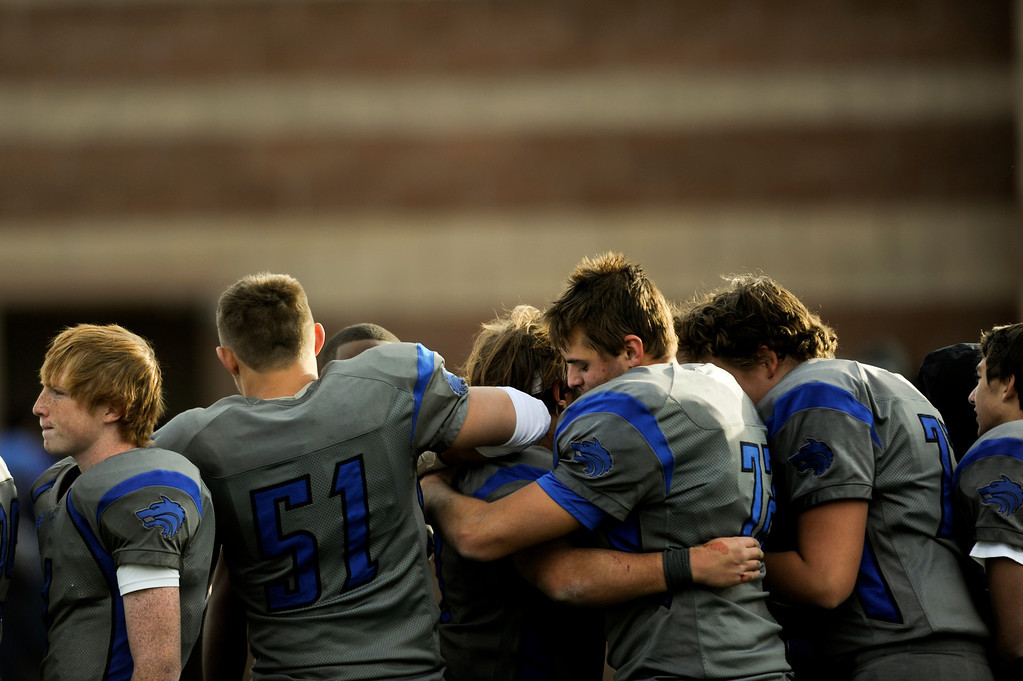 . AURORA CO: Nov. 16, 2013  Grandview players hug each other after their 9 - 13 loss to ThunderRidge.   (Photo By Erin Hull/The Denver Post)