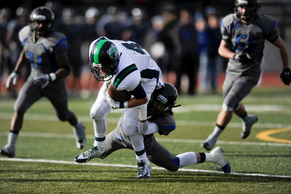 . AURORA CO: Nov. 16, 2013 ThunderRidge\'s Hayden Porter is tackled during the game against Grandview on Nov. 16, 2013 at Legacy Stadium in Aurora, CO. ThunderRidge won 13 - 9.  (Photo By Erin Hull/The Denver Post)