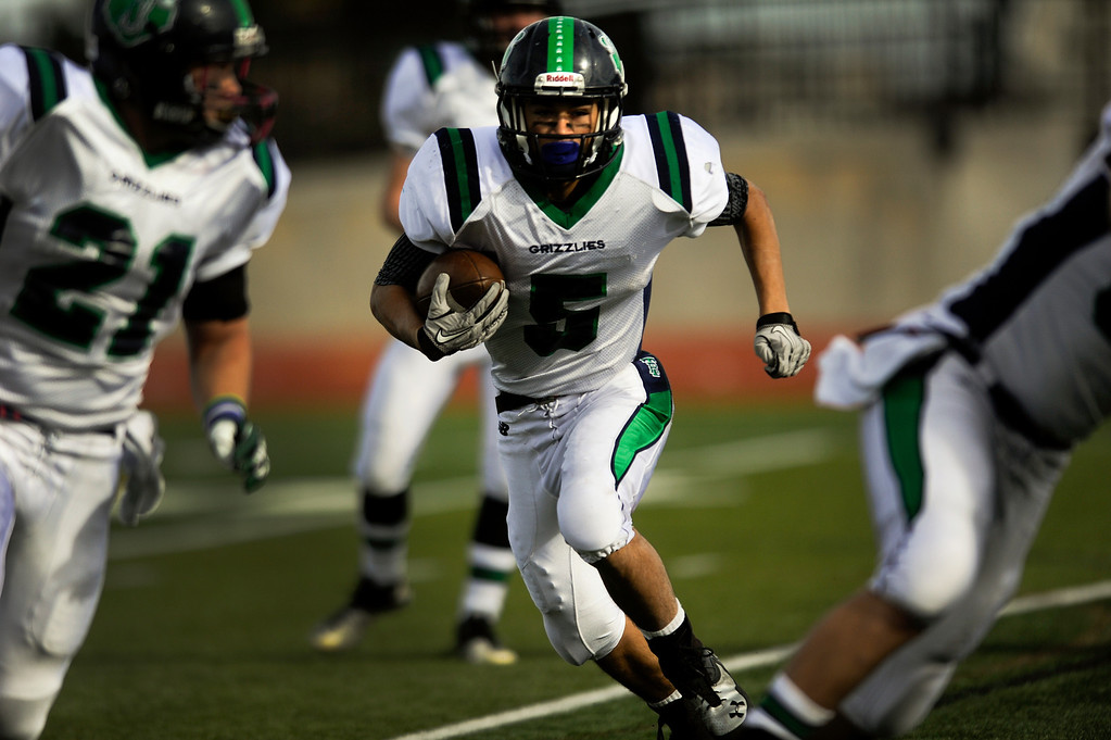 . AURORA CO: Nov. 16, 2013  ThunderRidge wide receiver Jon Jones carries the ball down field during his team\'s game against Grandview High School in Nov. 16, 2013 at Legacy Stadium in Aurora, CO. ThunderRidge won 13 - 9.   (Photo By Erin Hull/The Denver Post)