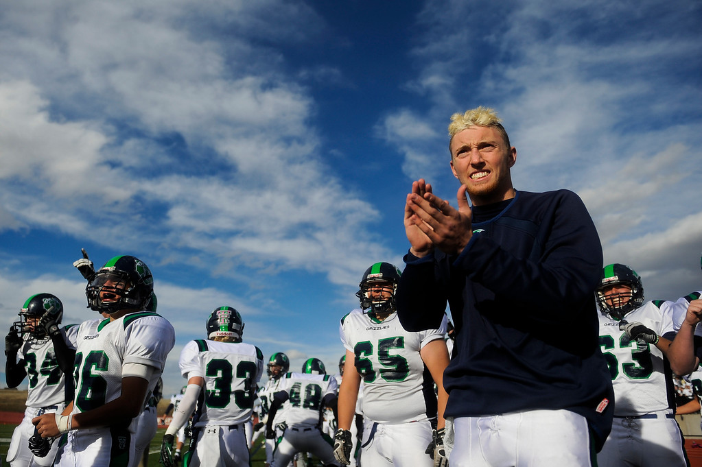 . AURORA CO: Nov. 16, 2013  ThunderRidge quarterback Brody Westmoreland cheers his team on during the second half. Westmoreland was injured in the first few minutes of play and was forced to sit the game out. Grandview High School took on ThunderRidge Saturday, Nov. 16, 2013 at Legacy Stadium in Aurora, CO. ThunderRidge won 13 - 9.   (Photo By Erin Hull/The Denver Post)