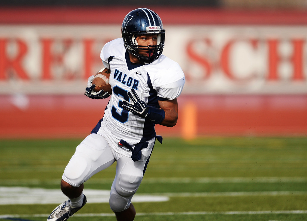 . AURORA CO. NOVEMBER 23 : Marcus Wilson of Valor Christian High School (3) is in action during the 5A football semifinal game against Cherokee Trail High School at Legacy Stadium in Aurora, Colorado November 23, 2013. Valor Christian won 42-23. (Photo by Hyoung Chang/The Denver Post)