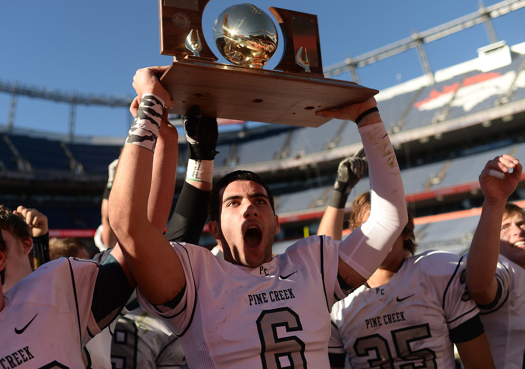 . Austin Meachum of Pine Creek High School (6) and teammates celebrate winning of 4A State Football Championship game against Montrose High School at Sports Authority Field. Denver, Colorado. November 30. 2013. Pine Creek won 49-14. (Photo by Hyoung Chang/The Denver Post)