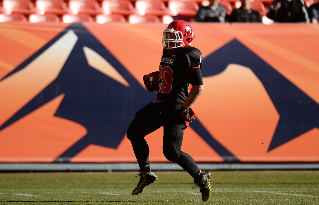 . RB Angelo Youngren of Montrose High School scored a touchdown in the 2nd half of 4A State Football Championship game against Pine Creek High School at Sports Authority Field. Denver, Colorado. November 30. 2013. Pine Creek won 49-14. (Photo by Hyoung Chang/The Denver Post)
