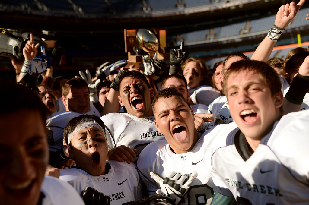 . Pine Creek High School football players celebrate winning of 4A State Football Championship game against Montrose High School at Sports Authority Field. Denver, Colorado. November 30. 2013. Pine Creek won 49-14. (Photo by Hyoung Chang/The Denver Post)