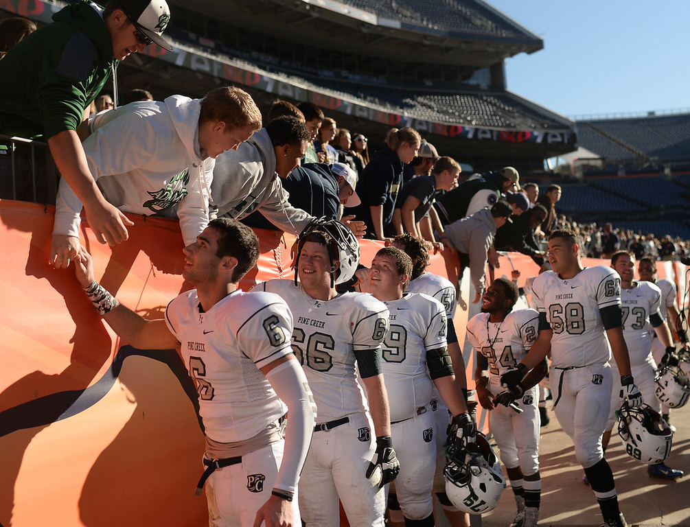 . Pine Creek High School football players celebrate winning the 4A State Football Championship game against Montrose High School at Sports Authority Field. Denver, Colorado. November 30. 2013. Pine Creek won 49-14. (Photo by Hyoung Chang/The Denver Post)