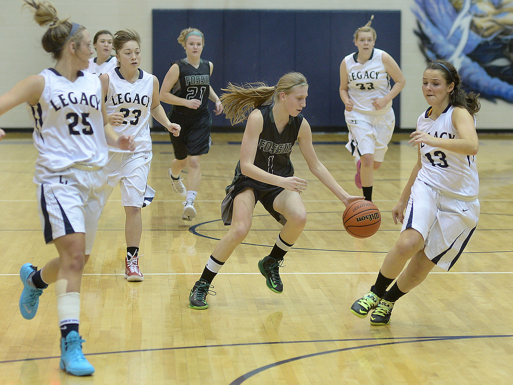 . WESTMINSTER, CO. - JANUARY 23:  SaberCats sophomore guard Sami Steffeck (1) weaved through traffic in the second half. The Fossil Ridge High School girl\'s basketball team defeated Legacy 61-52 Thursday night, January 23, 2014. Photo By Karl Gehring/The Denver Post