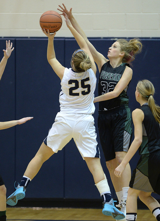 . WESTMINSTER, CO. - JANUARY 23:  SaberCats defender Kellee Willer (32) challenged Legacy shooter Bree Paulson (25) in the first half. The Fossil Ridge High School girl\'s basketball team defeated Legacy 61-52 Thursday night, January 23, 2014. Photo By Karl Gehring/The Denver Post