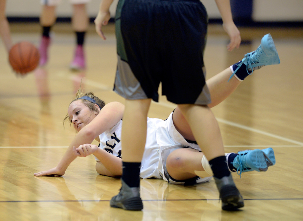 . WESTMINSTER, CO. - JANUARY 23:  Legacy junior guard Bree Paulson was fouled on her way down the court in the fourth quarter. The Fossil Ridge High School girl\'s basketball team defeated Legacy 61-52 Thursday night, January 23, 2014. Photo By Karl Gehring/The Denver Post