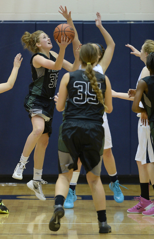 . WESTMINSTER, CO. - JANUARY 23:  SaberCats guard Kellee Willer (32) put up a shot in the second half. The Fossil Ridge High School girl\'s basketball team defeated Legacy 61-52 Thursday night, January 23, 2014. Photo By Karl Gehring/The Denver Post