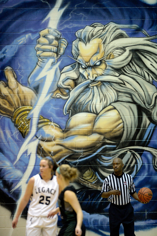 . WESTMINSTER, CO. - JANUARY 23:  An Israel Milstead mural provided a backdrop to the action Thursday night. The Fossil Ridge High School girl\'s basketball team defeated Legacy 61-52 Thursday night, January 23, 2014. Photo By Karl Gehring/The Denver Post