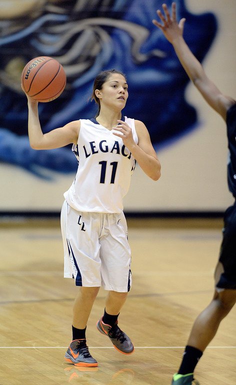. WESTMINSTER, CO. - JANUARY 23:  Legacy junior guard Miranda Romo (11) launched a long pass downcourt Thursday night. The Fossil Ridge High School girl\'s basketball team defeated Legacy 61-52 Thursday night, January 23, 2014. Photo By Karl Gehring/The Denver Post