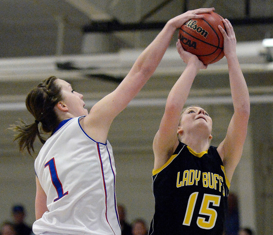 . Akron\'s Jordan Baer (1) blocks a shot by Caliche Sami Morgan (15) in 1A/2A action February 13, 2014 in Akron. (Photo by John Leyba/The Denver Post)