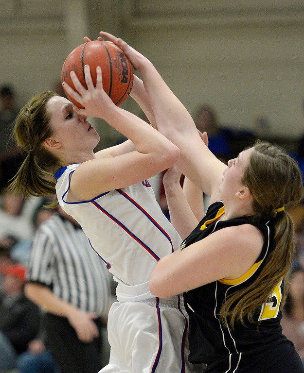 . Akron\'s Jordan Baer (1) gets her shot booked by Caliche\'s Jessica Taylor (35) in 1A/2A action February 13, 2014 in Akron. Taylor was called for a foul on the play. (Photo by John Leyba/The Denver Post)