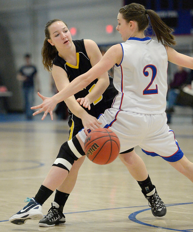 . Caliche\'s Shaylin Johnson (3) bounces a pass past Gail Hall (2) in 1A/2A action February 13, 2014 in Akron. (Photo by John Leyba/The Denver Post)