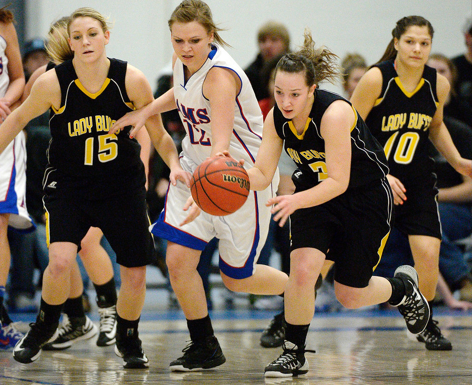 . Caliche\'s Shaylin Johnson steals the ball from Akron\'s Karli Christensen (12)  in 2A action February 13, 2014 in Akron. (Photo by John Leyba/The Denver Post)