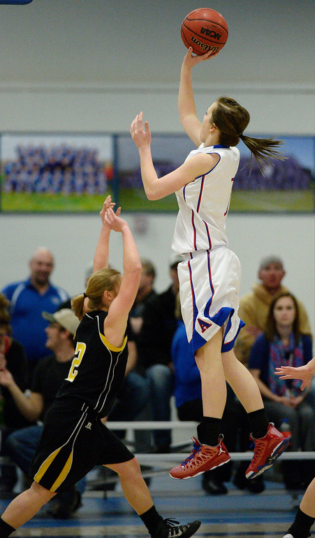 . Akron\'s Jordan Baer (1) takes a shot over Caliche\'s Jenna Zink in 1A/2A action February 13, 2014 in Akron. (Photo by John Leyba/The Denver Post)