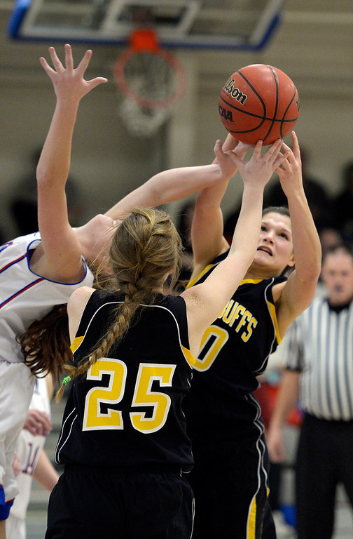 . Caliche\'s Rachael Edler battles for a rebound in 1A/2A action February 13, 2014 in Akron. Taylor was called for a foul on the play. (Photo by John Leyba/The Denver Post)