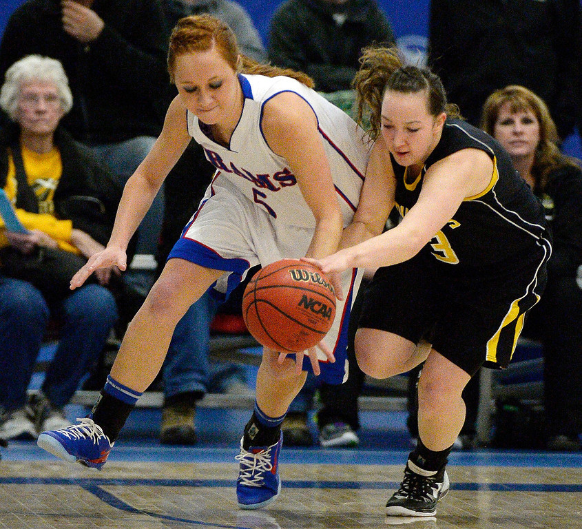. Caliche\'s Shaylin Johnson 93) steals the ball from Akron\'s A.J. Miller (5) in 1A/2A action February 13, 2014 in Akron. (Photo by John Leyba/The Denver Post)