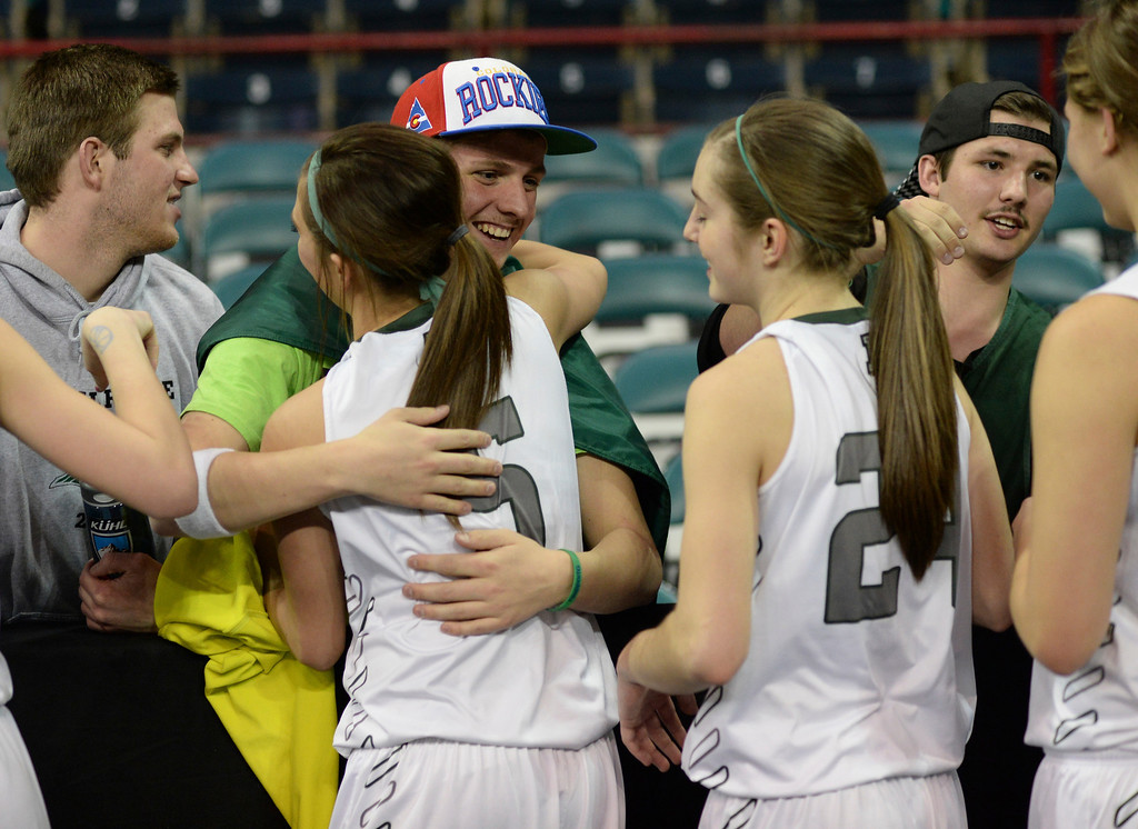 . DENVER, CO. - MARCH 6, 2014: The SaberCats greeted fans after the win. The Fossil Ridge School girl\'s basketball team defeated Dakota Ridge 60-50 in a 5A playoff game Thursday night, March 6, 2014 at the Denver Coliseum. Photo By Karl Gehring/The Denver Post