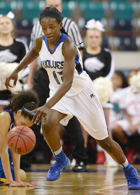 . Wolves freshman forward Michaela Onyenwere (12) made a steal in the first half. The Grandview High School girl\'s basketball team took on Rampart in a 5A playoff game Thursday night, March 6, 2014 in Denver, Colorado. (Photo by Karl Gehring/The Denver Post)