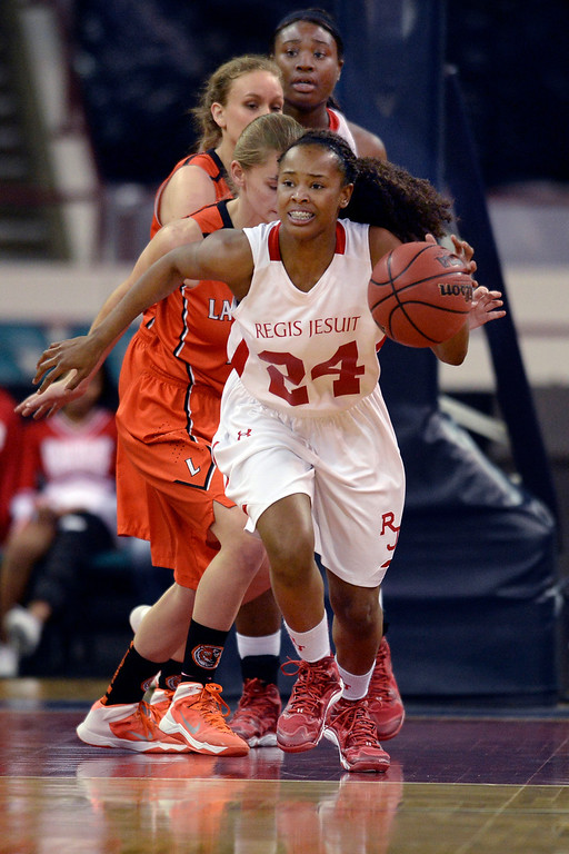 . Regis senior Neffie Lockley (24) started back up court in the first quarter. The Regis Jesuit High School girl\'s basketball team faced Lakewood in a 5A playoff game Thursday night, March 6, 2014 in Denver, Colorado. (Photo by Karl Gehring/The Denver Post)