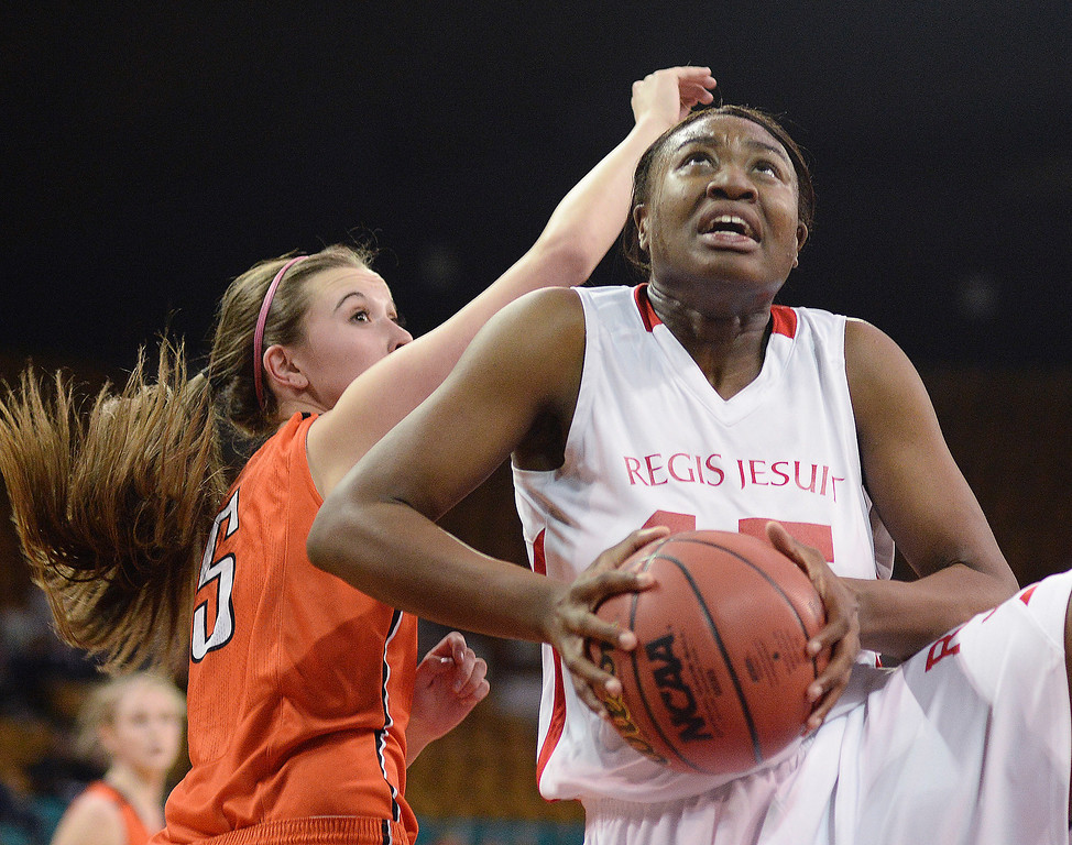 . Raiders senior Diani Akigbogun (15) grabbed a rebound in the first half. The Regis Jesuit High School girl\'s basketball team faced Lakewood in a 5A playoff game Thursday night, March 6, 2014 in Denver, Colorado. (Photo by Karl Gehring/The Denver Post)