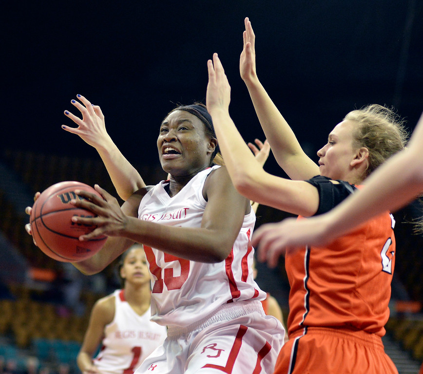 . Regis senior Diani Akigbogun (15) worked inside in the first quarter. The Regis Jesuit High School girl\'s basketball team faced Lakewood in a 5A playoff game Thursday night, March 6, 2014 in Denver, Colorado. (Photo by Karl Gehring/The Denver Post)