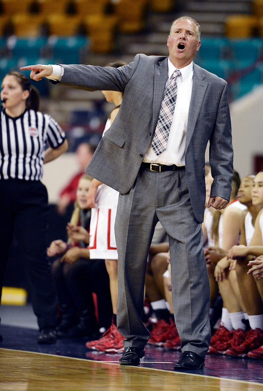 . Regis coach Carl Mattei had the girls running in the first half. The Regis Jesuit High School girl\'s basketball team faced Lakewood in a 5A playoff game Thursday night, March 6, 2014 in Denver, Colorado. (Photo by Karl Gehring/The Denver Post)