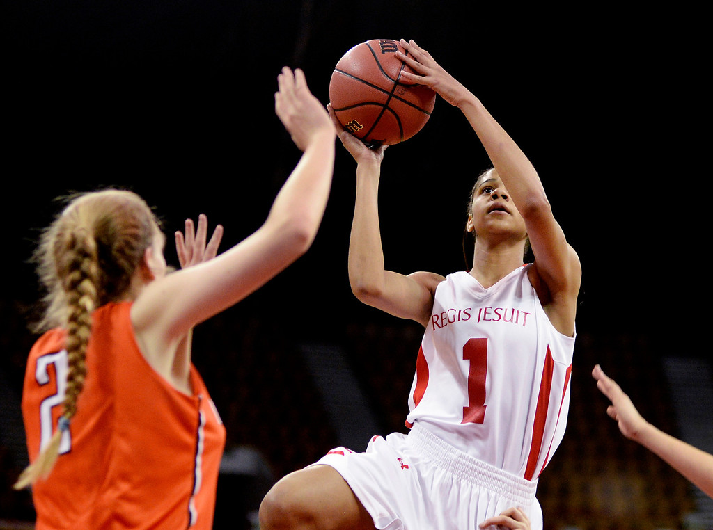 . Regis guard Justine Hall (1) looked for a shot in the first quarter. The Regis Jesuit High School girl\'s basketball team faced Lakewood in a 5A playoff game Thursday night, March 6, 2014 in Denver, Colorado. (Photo by Karl Gehring/The Denver Post)
