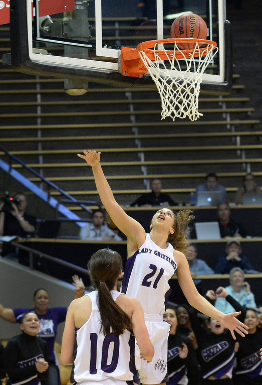 . Mesa Ridge senior guard Tiffani Jackson (21) watched her shot drop for the game winner with less than a second left in regulation.  (Photo by Karl Gehring/The Denver Post)