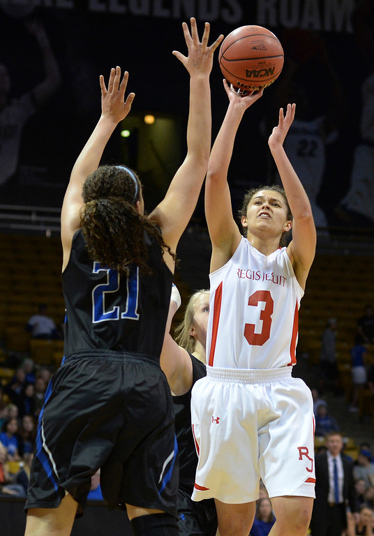 . Regis point guard Jessica Lewis (3) put up a shot over Poudre defender Myanne Hamm (21) in the second half.  (Photo by Karl Gehring/The Denver Post)