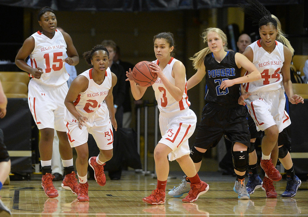. Regis guard Jessica Lewis turned with a rebound and headed back on offense in the first half.  (Photo by Karl Gehring/The Denver Post)