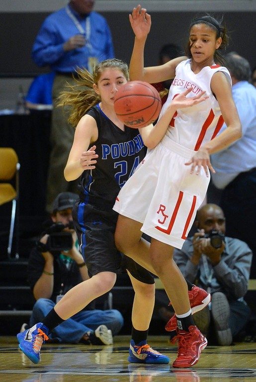 . Regis guard Justine Hall (1) knocked the ball away from Poudre\'s Anna Haugen (24)  in the first half.   (Photo by Karl Gehring/The Denver Post)