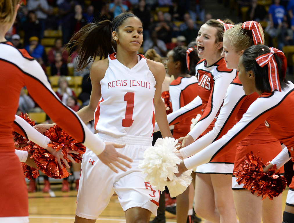 . Raiders\' guard Justine Hall was introduced prior to the game. The Regis Jesuit High School girl\'s basketball team took on Poudre in a 5A semifinal game. (Photo by Karl Gehring/The Denver Post)