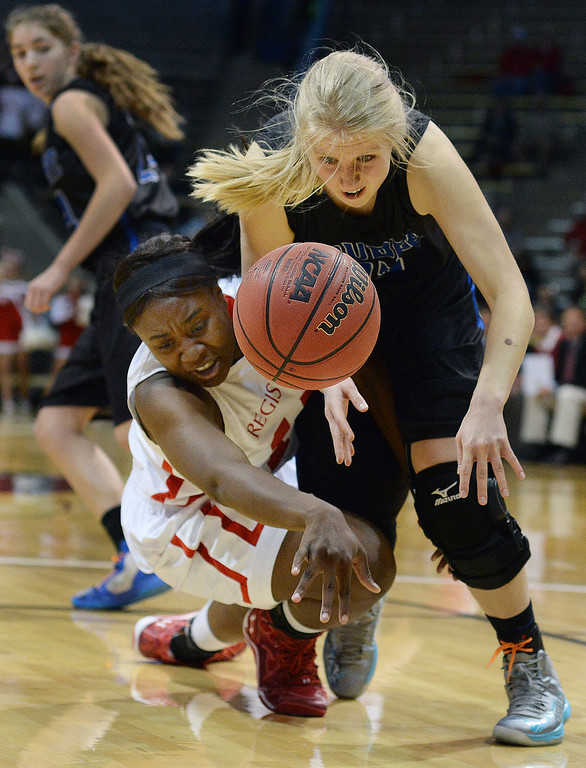 . Regis forward Diani Okigbogun (15) and Poudre senior McKenzie McDaniel (23) scrambled for a loose ball in the first half. (Photo by Karl Gehring/The Denver Post)