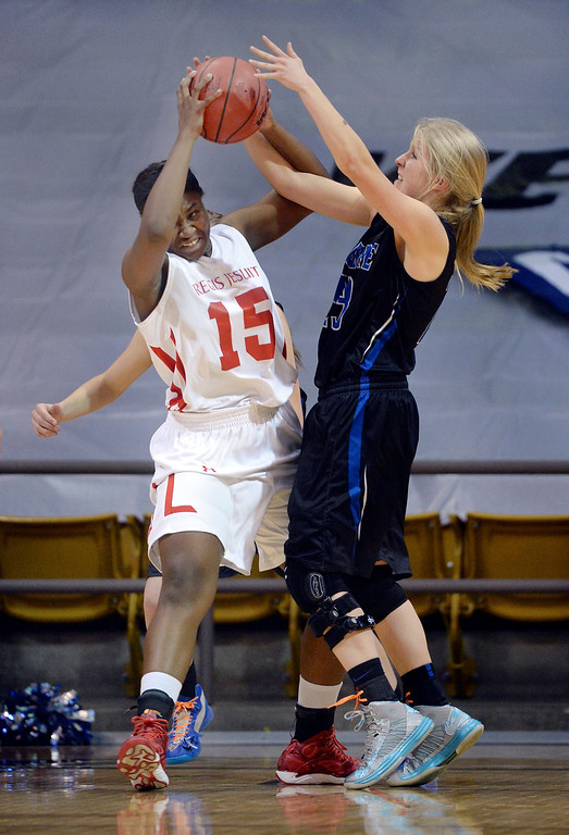 . Regis forward Diani Okigbogun i(15) battled for a rebound with Pudre forward McKenzie McDaniel (23) in the second half. (Photo by Karl Gehring/The Denver Post)