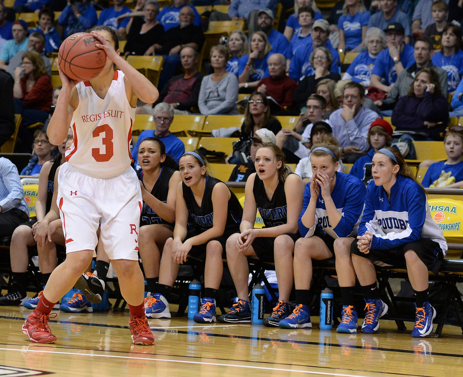 . The Poudre bench watched as Regis guard Jessica Lewis line up a three-pointer in the first half.   (Photo by Karl Gehring/The Denver Post)