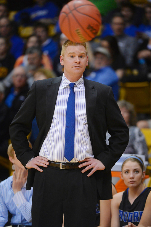 . Poudre coach Curtis Glesmann kept his eyes on the ball in the first half.  (Photo by Karl Gehring/The Denver Post)
