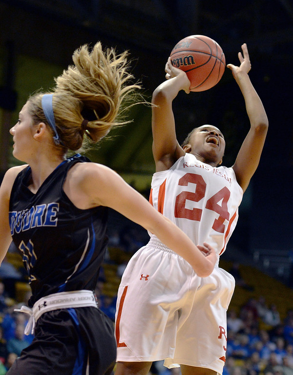 . Regis senior Neffie Lockley (24) saw a shot over Poudre defender Reagan Travis (11) in the second half. The Regis Jesuit High School girl\'s basketball team defeated Poudre 58-35 in a 5A semifinal game Thursday night, March 13, 2014 in Boulder, Colorado. (Photo by Karl Gehring/The Denver Post)