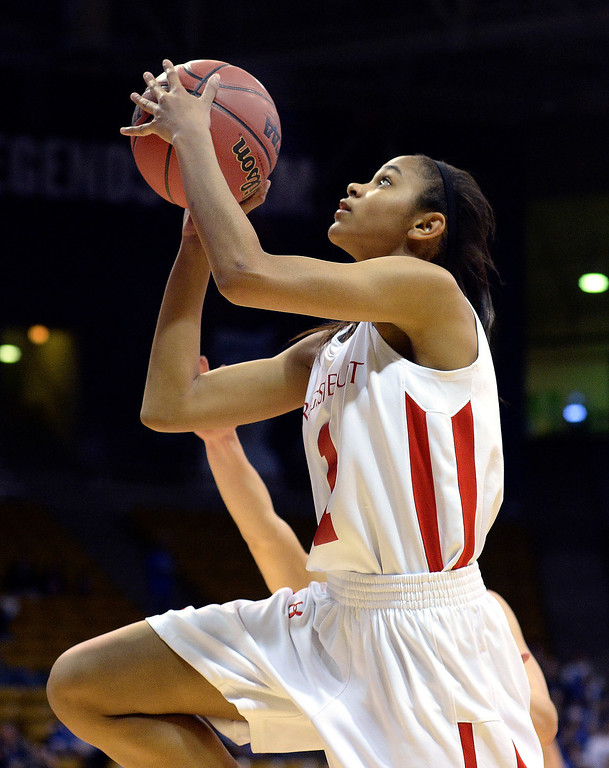 . Regis guard Justine Hall (1) drove to the bucket in the second half.  (Photo by Karl Gehring/The Denver Post)