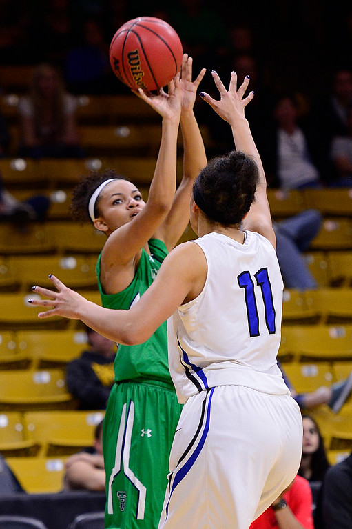 . Dallas Petties (21) of ThunderRidge shoots over the hand of Blaire Braxton (11) of Highlands Ranch during the fourth quarter at the Coors Events Center on March 12, 2016 in Boulder, Colorado. ThunderRidge defeated Highlands Ranch 47-32 to win the Class 5A Colorado State Basketball Championship. (Photo by Brent Lewis/The Denver Post)