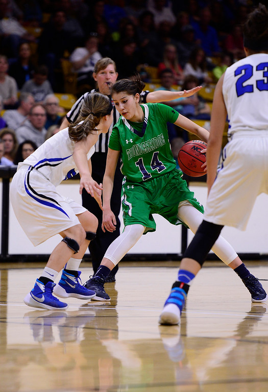 . Alyssia Martinez (14) of ThunderRidge goes for a crossover on a Highlands Ranch defender during the fourth quarter at the Coors Events Center on March 12, 2016 in Boulder, Colorado. ThunderRidge defeated Highlands Ranch 47-32 to win the Class 5A Colorado State Basketball Championship. (Photo by Brent Lewis/The Denver Post)