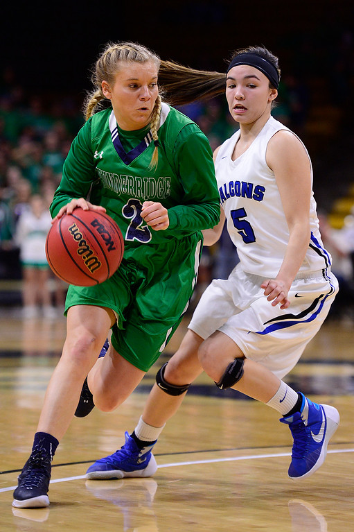 . Madison Ward (2) of ThunderRidge drives to the basket around Tommi Olson (5) of Highlands Ranch during the first quarter at the Coors Events Center on March 12, 2016 in Boulder, Colorado. (Photo by Brent Lewis/The Denver Post)