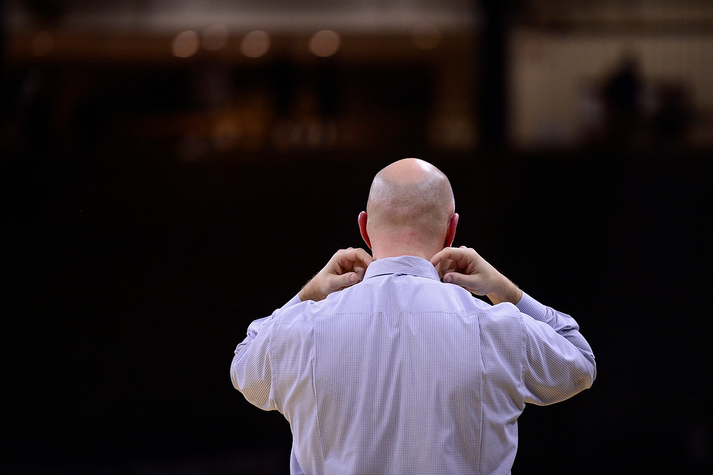 . Head coach Matthew Asik of ThunderRidge fixes his collar after screaming at a referee during the fourth quarter at the Coors Events Center on March 12, 2016 in Boulder, Colorado. ThunderRidge defeated Highlands Ranch 47-32 to win the Class 5A Colorado State Basketball Championship. (Photo by Brent Lewis/The Denver Post)
