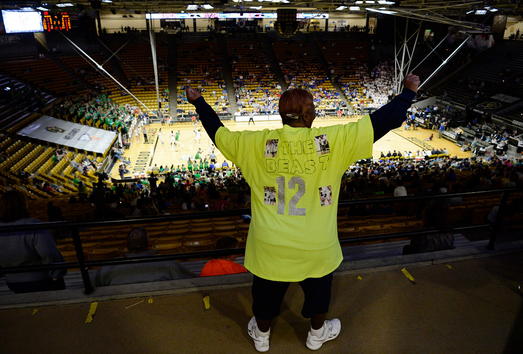 . Too much nervous energy, pride and overall excitement keeps Lois Rogers out of her seat while watching her granddaughter ThunderRidge Grizzlies Jaz\'myne �The Beast� Snipes #12 plays against Highlands Ranch during the Colorado State 5A girls Championship game at the CU Coors Events Center March 12, 2016. ThunderRidge won 47-32. (Photo by Andy Cross/The Denver Post)