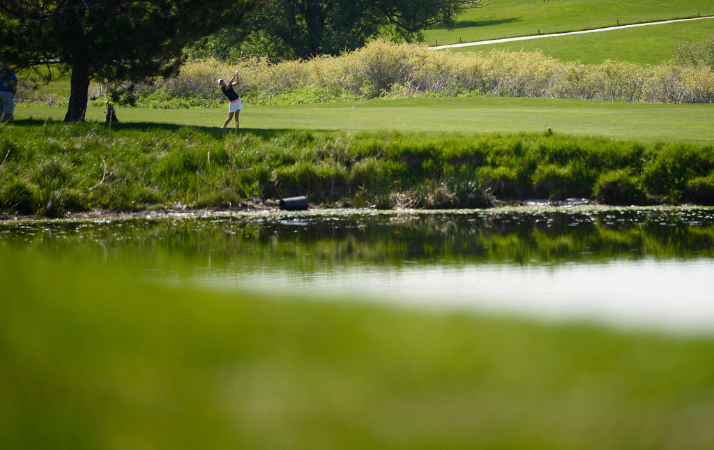 . LITTLETON, CO - MAY 20: Delaney Benson, of Heritage High School, chips onto the green on hole two at Raccoon Creek Golf Course in Littleton, May 20, 2014. Benson joined other class 5A girls golfers during the Colorado State High School Golf Tournament. (Photo by RJ Sangosti/The Denver Post)