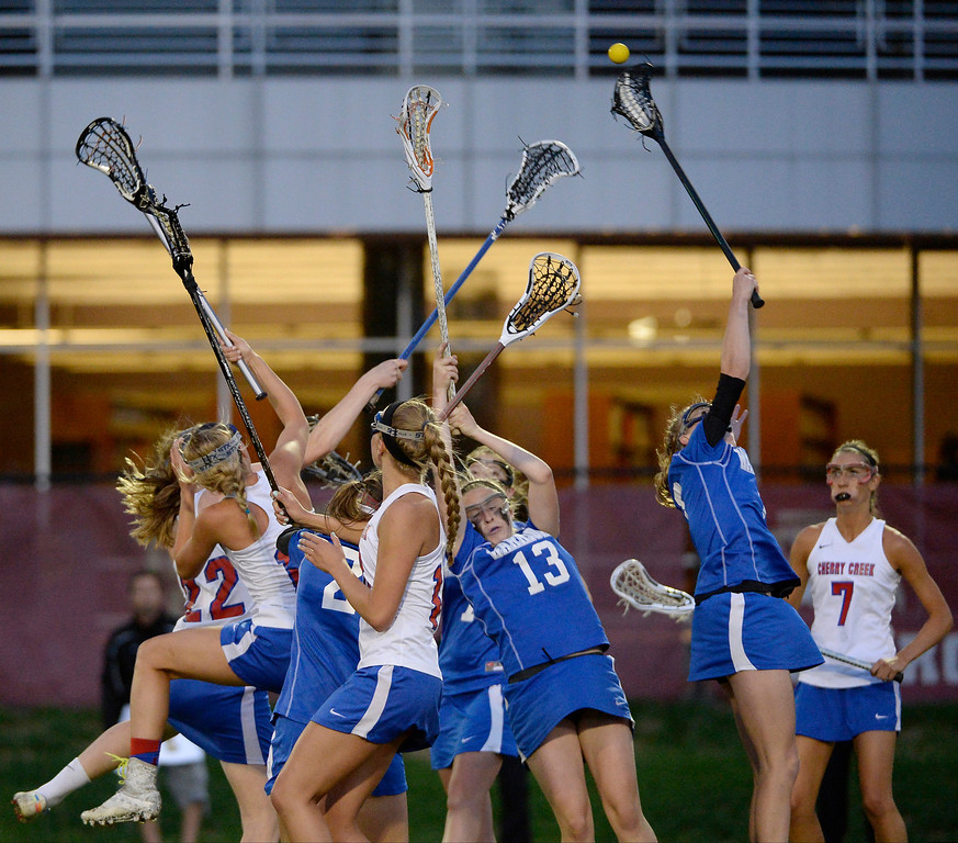 . Cherry Creek and Centaurus go up for the ball during their lacrosse state championship game. (Photo By John Leyba/The Denver Post)