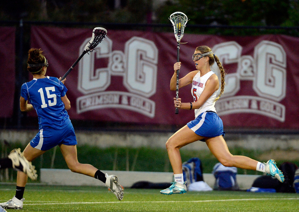. Cherry Creek Nellie List (5) heads up field as Centaurus Katie Coleman (15) comes up on defense during their lacrosse state championship game. (Photo By John Leyba/The Denver Post)