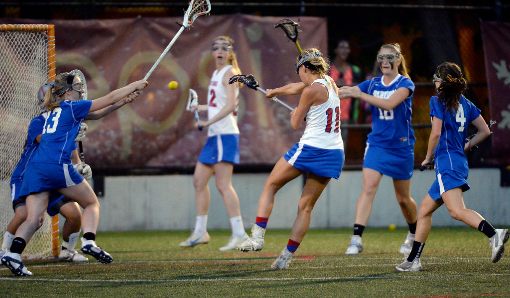 . Cherry Creek Blair Sisk (11) takes a shot on goal against Centaurus during their lacrosse state championship game. (Photo By John Leyba/The Denver Post)